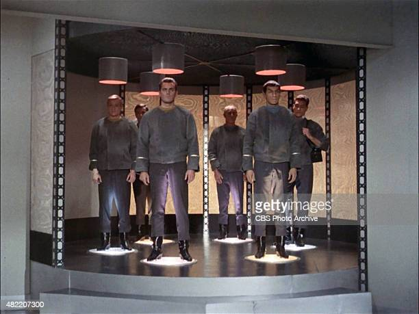 The crew of the USS Enterprise being transported From left Peter Duryea as Lieutenant Jos Tyler Adam Roarke as Communications Officer Garison Jeffrey...