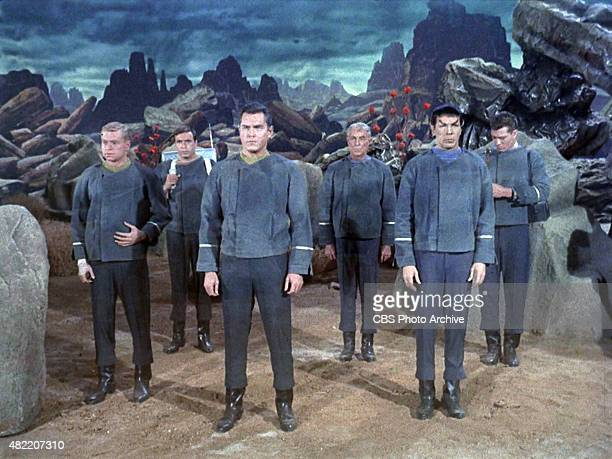 The crew of the USS Enterprise on Talos IV from left Peter Duryea as Lieutenant Jos Tyler Adam Roarke as Communications Officer Garison Jeffrey...
