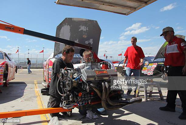 The crew of Thomas Martin pulls the engine on the Greyhound Adoption Center Cherolet in preparation for the Toyota/NAPA Auto Parts Bonus Challenge...