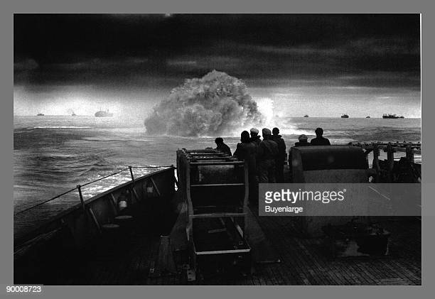 The crew of US Coast Guard cutter Spencer watch one of their depth charges explode as they defend a convoy during a Uboat attack in the North...