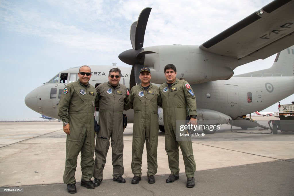 The crew poses for the camera with the C27-J Spartan plain that aids flood victims from the North of Peru at Callao airport on March 27, 2017 in Callao, Peru. El Nino is causing severe storms since the begining of the rainy season in Peru now leaving more than 80 dead and at least 111,000 affected all over the territory.