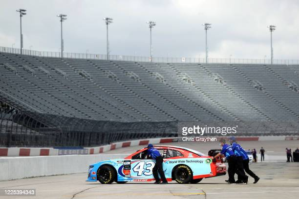 The crew push the World Wide Technology Chevrolet driven by Bubba Wallace through the track prior to the NASCAR Cup Series The Real Heroes 400 at...