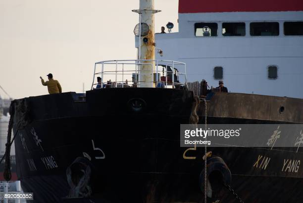 The crew work on a ship off the Keihin industrial area of Kawasaki Kanagawa Prefecture Japan on Tuesday Dec 12 2017 The Bank of Japan will release...