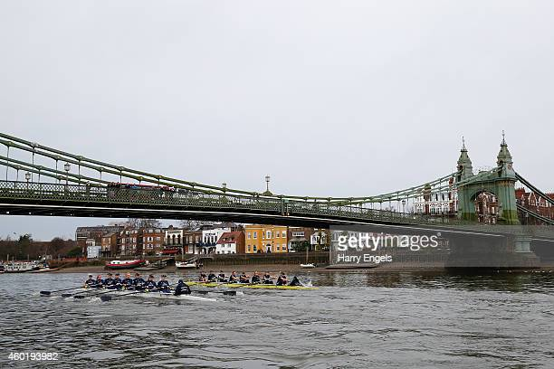 The crews row under Hammersmith Bridge during the Oxford University Women's Boat Club trial eights race on the River Thames on December 9 2014 in...