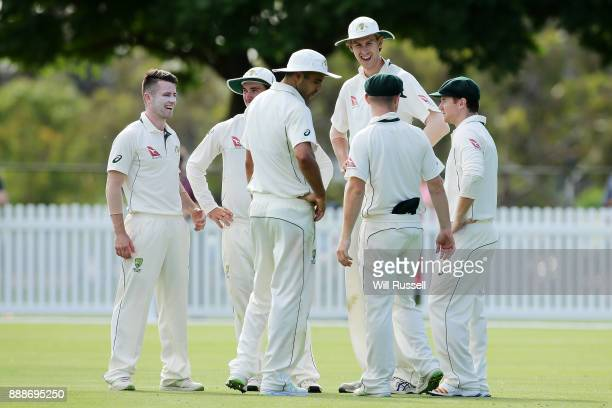 The Cricket Australia XI celebrates after taking the wicket of Mason Crane of England during the Two Day tour match between the Cricket Australia CA...