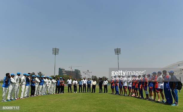 The cricket teams of Afghanistan and Namibia stand during a ceremony during the ICC Intercontinental Cup between Afghanistan and Namibia at a cricket...