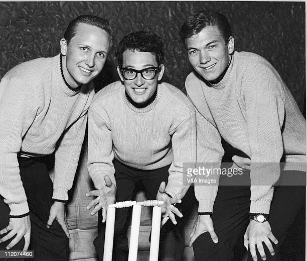 The Crickets Joe B Mauldin Buddy Holly Jerry Allison posed group shot standing behind cricket stumps March 1958