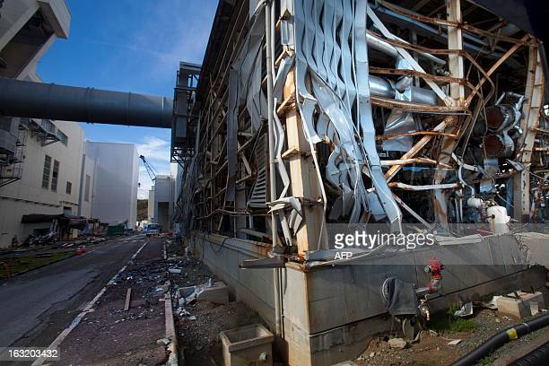 The crippled Fukushima Daiichi nuclear power station is seen through a bus window in Okuma on November 12 2011 Japan took a group of journalists...