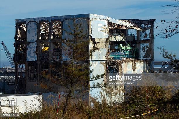 The crippled Fukushima Daiichi nuclear power station is seen through a bus window in Okuma Japan Saturday Nov 12 2011 Media allowed into Japan's...