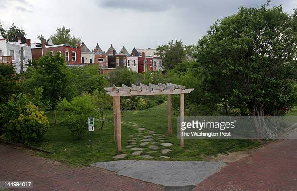 The Crispus Attucks Park a community treasure behind row houses on U and V Sts NW is the subject of a dispute over who has control the existing park...