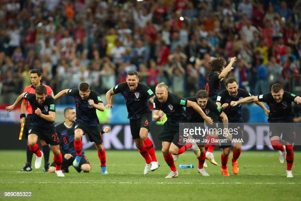 The Croatia players celebrate after winning a penalty shootout during the 2018 FIFA World Cup Russia Round of 16 match between Croatia and Denmark at...