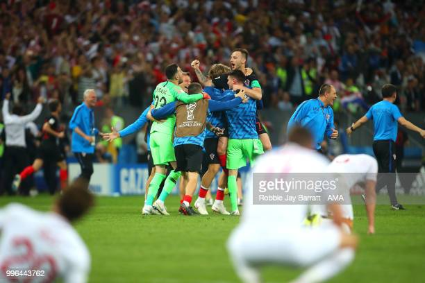 The Croatia players celebrate at the end of extra time during the 2018 FIFA World Cup Russia Semi Final match between Croatia and England at Luzhniki...