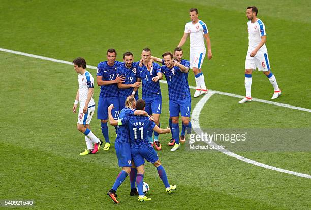 The Croatia team celebrate with Ivan Perisic of Croatia after he scored his sides first goal during the UEFA EURO 2016 Group D match between Czech...