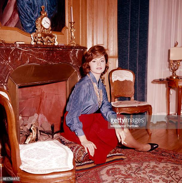 The Croatian actress Sylva Koscina seated in front of a fireplace and wearing a red skirt and an indigo blouse the actress who moved to Italy when...