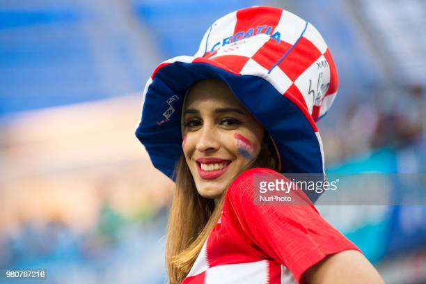 The Croatian fan poses for photo during the FIFA World Cup Group D match between Argentina and Croatia at Nizhny Novogorod Stadium in Nizhny...