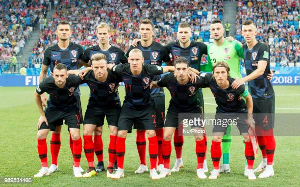 The Croatian national football team poses for a photo during the 2018 FIFA World Cup Round of 16 match between Croatia and Denmark at Nizhny Novgorod...