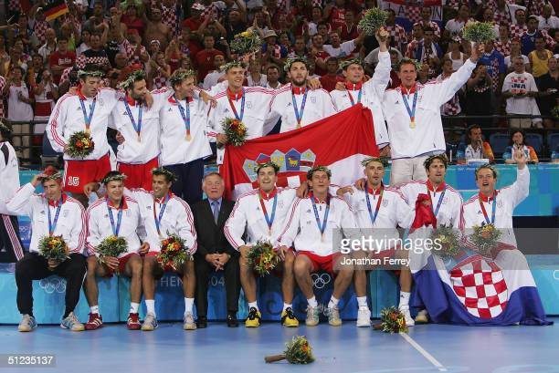 The Croatian team celebrate after receiving the gold medal for the men's handball event on August 29 2004 during the Athens 2004 Summer Olympic Games...