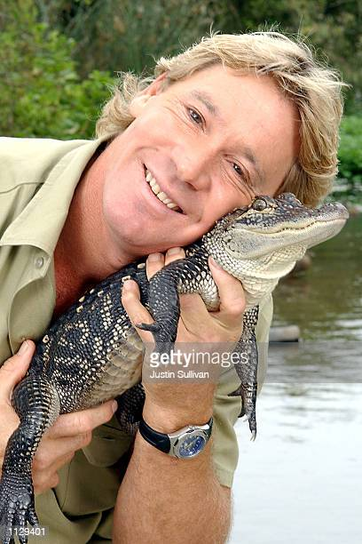 "The Crocodile Hunter"", Steve Irwin, poses with a three foot long alligator at the San Francisco Zoo on June 26, 2002 in San Francisco, California...."
