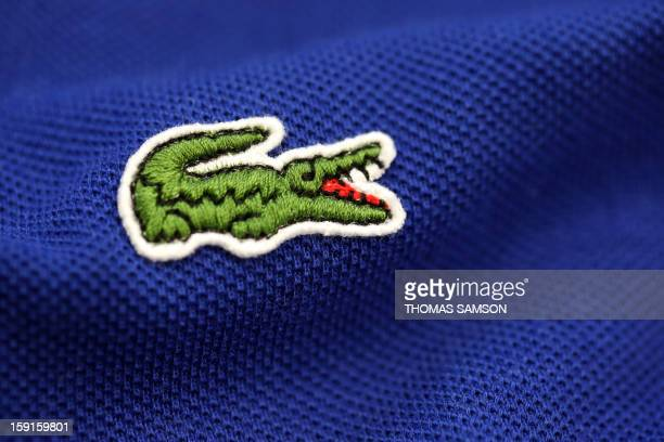 2337dff07b38 The crocodile shaped logo of French apparel company Lacoste is pictured on a  polo on January