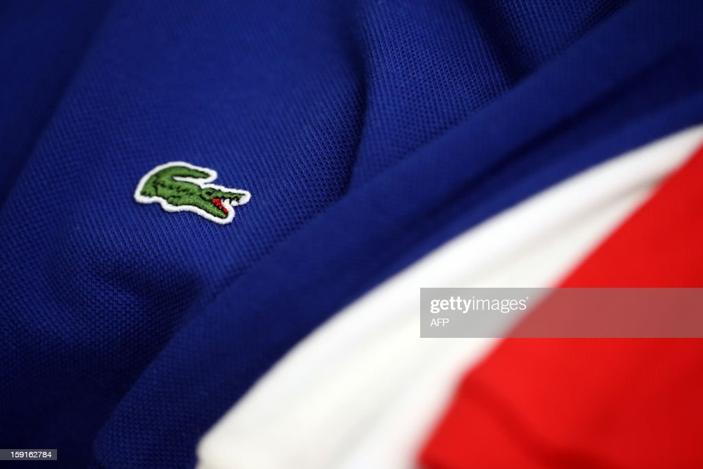 The crocodile shaped logo of French apparel company Lacoste is pictured on a polo, on January 9, 2013 in Paris.