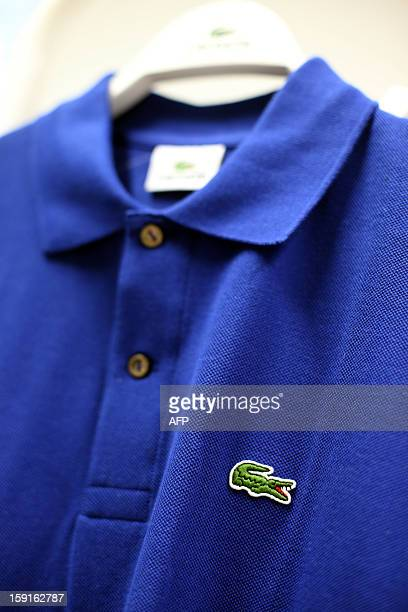 The crocodile shaped logo of French apparel company Lacoste is pictured on a polo on January 9 2013 in Paris AFP PHOTO THOMAS SAMSON