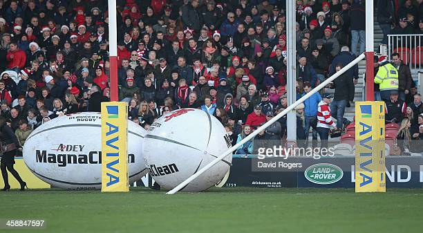 The cross bar on the post lies on the ground after being damaged during the pre match entertainment during the Aviva Premiership match between...