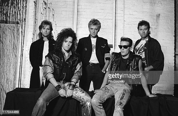 The Cross British rock band pose for a group portrait in front of a whitewashed brick wall in August 1987 The Cross were a side project of Queen...