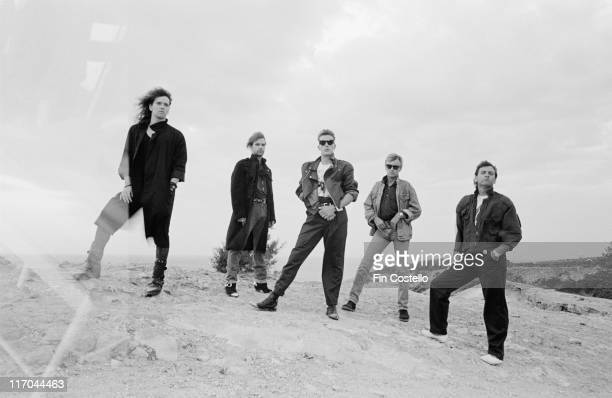 The Cross British rock band pose for a group portrait in Ibiza Spain in August 1987 The Cross were a side project of Queen drummer Roger Taylor who...