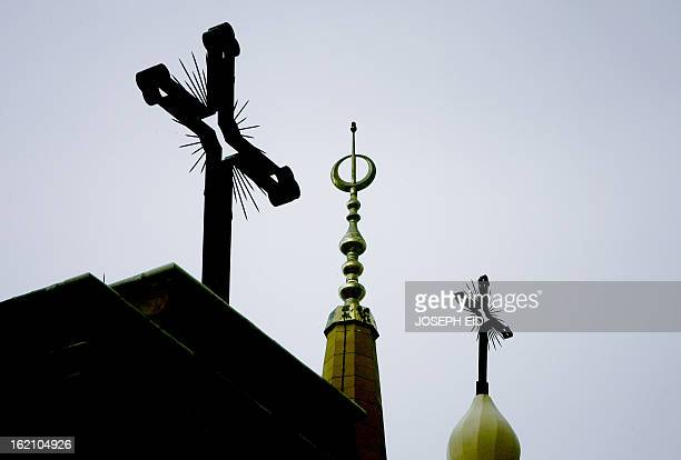 The cross of the the Maronite cathedral of Saint Georges is seen side by side along with the minaret of Moahmmed alAmin Mosque in downtown Beirut on...