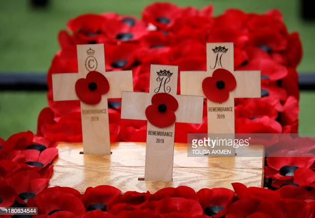 The Crosses of Remembrance placed by Britain's Prince Harryn and Meghan Duchess of Sussex are pictured following their visit to the Field of...