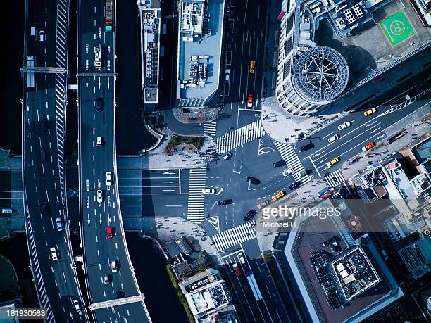the crossing way of nihonbashi in tokyo - overhead view of traffic on city street tokyo japan stock photos and pictures