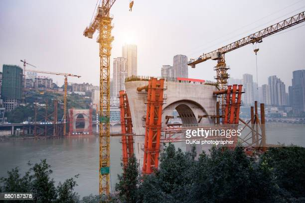 the cross-river bridge in construction  chongqing china - chongqing stock photos and pictures