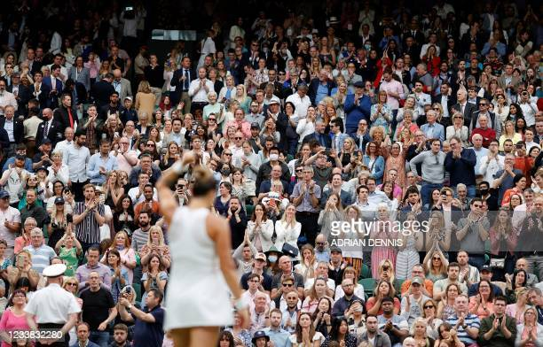 The crowd applaud as Belarus's Aryna Sabalenka celebrates winning against Tunisia's Ons Jabeur during their women's quarter-final tennis match on the...