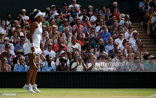 The crowd applaud as Britain's Heather Watson won a point aginst US player Serena Williams during their women's singles third round match on day five...