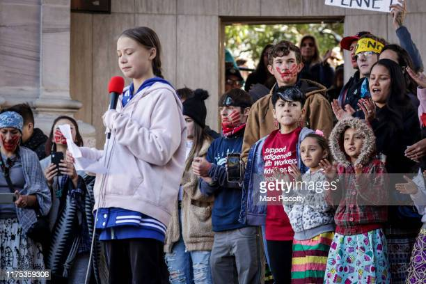 The crowd applauds Swedish teen activist Greta Thunberg as she speaks at the Fridays For Future Denver Climate Strike on October 11 2019 at Civic...