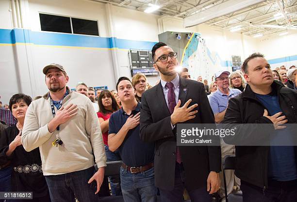 The crowd at a rally for Republican presidential candidate Sen Ted Cruz says the pledge of allegiance at the Boys Girls Club of Truckee Meadows in...