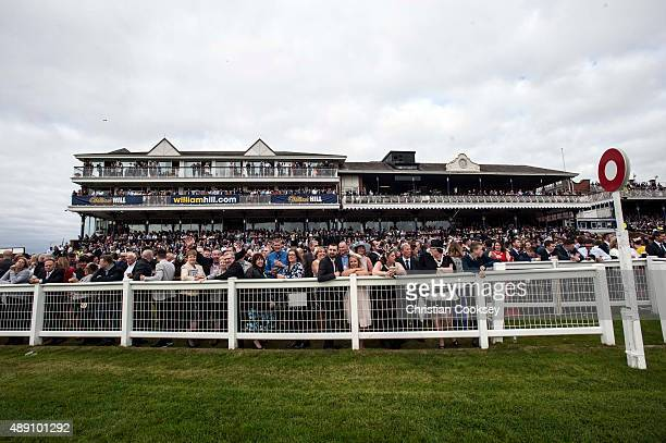 The crowd at Ayr racecourse get ready for the William Hill Ayr Silver Cup on September 19 2015 in Ayr Scotland