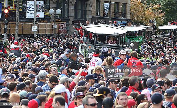 The crowd at Boston City Hall Plaza cheers as the duck boats make their way down Tremont Street during the World Series victory parade for the Boston...