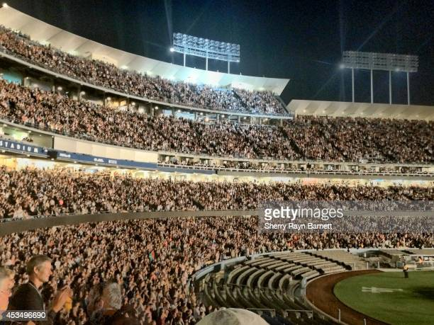 The crowd at Dodger Stadium enjoy a concert by Paul McCartney on August 10 2014 in Los Angeles California
