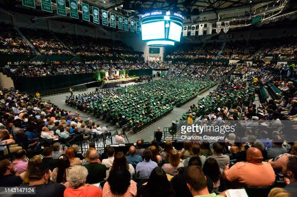 The crowd at Halton Arena pauses for a moment of silence during UNC Charlotte's College of Liberal Arts Sciences commencement ceremony on Saturday...