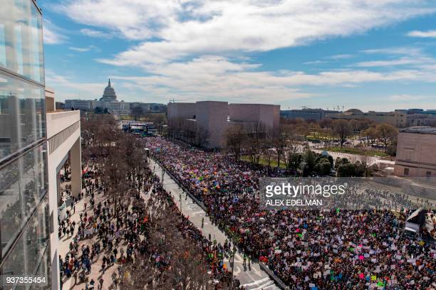 TOPSHOT The crowd at the March for Our Lives Rally as seen from the roof of the Newseum in Washington DC on March 24 2018 Galvanized by a massacre at...