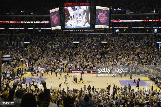 The crowd attending the game between the San Antonio Spurs and the Los Angeles Lakers cheers for the Laker victory in Game four of the Western...