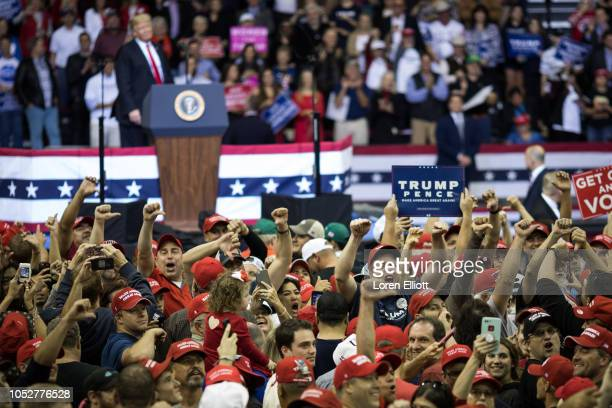 The crowd boos members of the media during President Donald Trump's speech at a rally in support of Sen Ted Cruz on October 22 2018 at the Toyota...