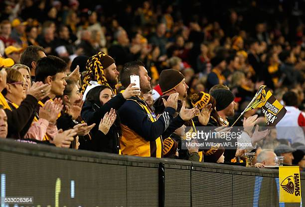 The crowd breaks into a round of applause after Jarryd Roughead was shown on the big screen during the 2016 AFL Round 09 match between the Hawthorn...