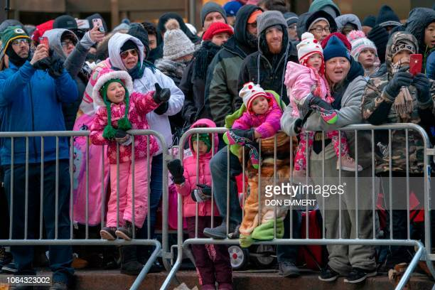 The crowd bundles up against the cold to watch the 92nd Annual Macy's Thanksgiving Day Parade on November 22 in New York
