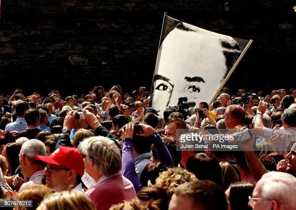 The crowd carry giant pictures of the victims of Bloody Sunday while they march through Londonderry from Free Derry Corner to the Guildhall where...