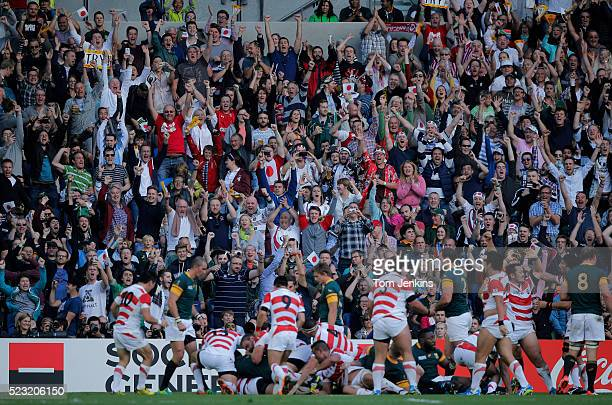 The crowd celebrate a Japanese try during the South Africa v Japan Pool B Rugby World Cup match at Brighton Community Stadium on September 19th 2015...