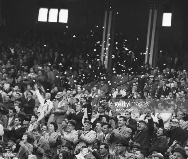 The crowd celebrates a New York Giants victory during a game at Yankee Stadium New York New York October 1958