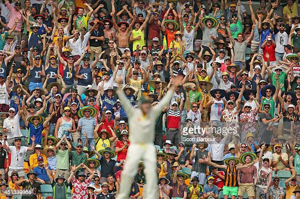 The crowd celebrates after Steven Smith of Australia took a catch to dismiss Ian Bell of England during day two of the First Ashes Test match between...
