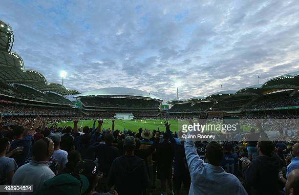 The crowd celebrates an Australian wicket during day one of the Third Test match between Australia and New Zealand at Adelaide Oval on November 27,...